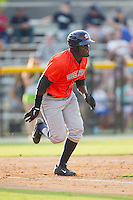 Ydarqui Marte (12) of the Greeneville Astros hustles down the first base line against the Burlington Royals at Burlington Athletic Park on June 29, 2014 in Burlington, North Carolina.  The Royals defeated the Astros 11-0. (Brian Westerholt/Four Seam Images)
