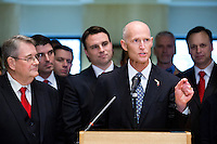TALLAHASSEE, FLA. 5/3/13-SESSIONEND050313CH-Gov. Rick Scott, right, talks about the accomplishments of the 2013 legislative session during a news conference with Senate President Don Gaetz, R-Niceville, left, and House Speaker Will Weatherford, R-Wesley Chapel, May 3, 2013 at the Capitol in Tallahassee...COLIN HACKLEY PHOTO