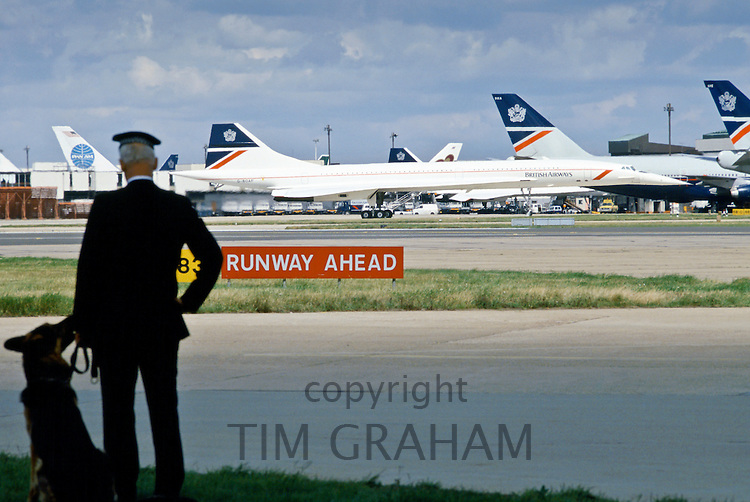 Police security by British Airways Concord aeroplane near the VIP Suite at Heathrow Airport in London, UK