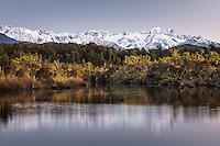 Pastel colours of twilight over Southern Alps with Mt. Cook and Mt. Tasman from Okarito Lagoon, Westland Tai Poutini National Park, West Coast, UNESCO World Heritage Area, South Westland, New Zealand, NZ