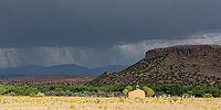 Black Mesa is a well known landmark in northern New Mexico.  An all to infrequent afternoon rainstorm passes through the Espanola Valley on this afternoon.