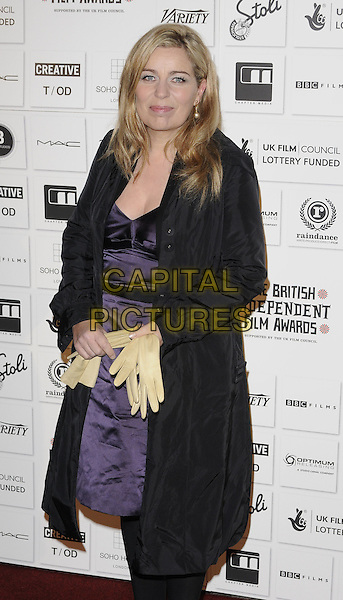 LONE SCHERFIG.Attending The British Independent Film Awards,The Brewery, London, England, UK, December 6th 2009. .arrivals half length black coat purple dress hands holding gloves .CAP/CAN.©Can Nguyen/Capital Pictures