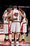 MADISON, WI - NOVEMBER 3: The Wisconsin Badgers huddle during the game against the University of Wisconsin-Stout Blue Devils at the Kohl Center on September 3, 2006 in Madison, Wisconsin. The Badgers beat the Blue Devils 82-33. Photo by David Stluka