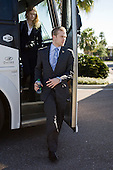 Laura Reed (Maine) and Spencer Abbott (Maine) disembark from their bus. - The members of the Hobey Hat Trick take a bus to MacDill Air Force Base from Channelside Bay Plaza for the award ceremony on Friday, April 6, 2012, in Tampa, Florida.