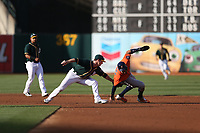 OAKLAND, CA - SEPTEMBER 9: Carlos Correa #1 of the Houston Astros is tagged out at second base against the Oakland Athletics by A's second baseman Joey Wendle #52 during game 2 of a doubleheader at the Oakland Coliseum on Saturday, September 9, 2017 in Oakland, California. (Photo by Brad Mangin)