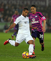 (L-R) Wayne Routledge of Swansea City is challenged by Steven Pienaar of Sunderland during the Premier League match between Swansea City and Sunderland at The Liberty Stadium, Swansea, Wales, UK. Saturday 10 December 2016