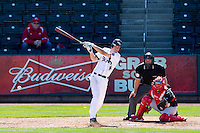 Eric Cheray (14) of the Missouri State Bears follows through his swing after making contact on a pitch during a game against the Southern Illinois University- Edwardsville Cougars at  Hammons Field on March 10, 2012 in Springfield, Missouri. (David Welker / Four Seam Images)