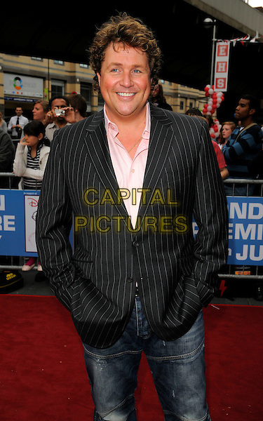 "MICHAEL BALL .Attending the ""High School Musical"" stage show Press Night at the Hammersmith Apollo Theatre, London, England, UK, July 5th 2008..outside arrivals half length pinstripe suit gray grey jeans.CAP/CAN.©Can Nguyen/Capital Pictures"