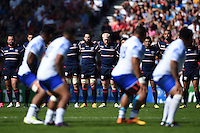 The USA team look on as Samoa perform the Siva Tau. Rugby World Cup Pool B match between Samoa and the USA on September 20, 2015 at the Brighton Community Stadium in Brighton, England. Photo by: Patrick Khachfe / Onside Images