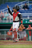 Batavia Muckdogs catcher Pablo Garcia (4) signals to the defense during a game against the Williamsport Crosscutters on June 22, 2018 at Dwyer Stadium in Batavia, New York.  Williamsport defeated Batavia 9-7.  (Mike Janes/Four Seam Images)