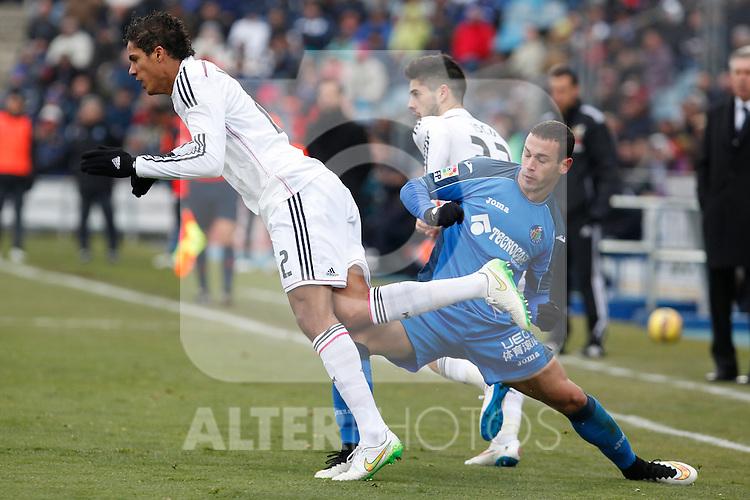Getafe´s Alvaro and Real Madrid´s Raphael Varane during La Liga match at Coliseum Alfonso Perez stadium  in Getafe, Spain. January 18, 2015. (ALTERPHOTOS/Victor Blanco)