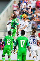 June 07, 2014:   the United States of America defender Geoff Cameron (20) heads a ball during action between the USA Men's National Soccer team and Nigeria at EverBank Field in Jacksonville, Florida.  This is the last match before the USA team leaves for Brazil and the 2014 World Cup Championships. The USA Men's National Team defeated Nigeria 2-1.