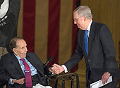 United States Senate Majority Leader Mitch McConnell (Republican of Kentucky), right, shakes hands with former US Senator Bob Dole (Republican of Kansas), left, prior to making remarks at a Congressional Gold Medal ceremony honoring Dole that was also attended by US President Donald J. Trump in the Rotunda of the US Capitol on Wednesday, January 17, 2017.  Congress commissioned gold medals as its highest expression of national appreciation for distinguished achievements and contributions.  Dole served in Congress from 1961 through 1996, was the Senate GOP leader from 1985 through 1996, and was the 1996 Republican Party nominee for President of the United States.<br /> Credit: Ron Sachs / CNP