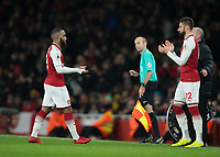 Alexandre Lacazette of Arsenal is replaced by Olivier Giroud of Arsenal during the Premier League match between Arsenal and Newcastle United at the Emirates Stadium, London, England on 16 December 2017. Photo by Vince  Mignott / PRiME Media Images.