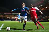 Harrison McGahey of Rochdale and Jordy Hiwula of Fleetwood battle for a loose ball during the Sky Bet League 1 match between Rochdale and Fleetwood Town at Spotland Stadium, Rochdale, England on 20 March 2018. Photo by Thomas Gadd.