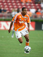 Houston Dynamo midfielder Ricardo Clark (13) advances the ball.  Houston Dynamo defeated FC Dallas 1-0 in an MLS regular season match at Robertson Stadium in Houston, TX on August 19, 2007.