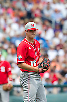 North Carolina State Wolfpack pitcher Carlos Rodon #16 looks on during Game 3 of the 2013 Men's College World Series between the North Carolina State Wolfpack and North Carolina Tar Heels at TD Ameritrade Park on June 16, 2013 in Omaha, Nebraska. The Wolfpack defeated the Tar Heels 8-1. (Brace Hemmelgarn/Four Seam Images)