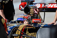 Romain Grosjean of Lotus F1 Team driving (8) E22 in the pit road during second practice session of  2014 Formula 1 United States Grand Prix, Friday, October 31, 2014 in Austin, Tex. (Mo Khursheed/TFV Media via AP Images)