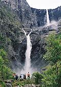 Waterval Mardalsfossen Noorwegen | Waterfall Mardalsfossen Norway.<br /> <br /> Mardalsfossen is een bekende waterval in de gemeente Nesset in Noorwegen. Het water valt 705 meter naar beneden, met tussenliggende rotsen. De langste vrije val van het water is 297 meter. Dat is de hoogste vrije val van Scandinavi&euml; en de op drie na hoogste ter wereld. Het water komt uit het op 945 m hoogte gelegen meer de Mardalstj&oslash;nna.<br /> <br /> Mardalsfossen is one of the ten highest waterfalls in Europe. It is located in the municipality of Nesset in M&oslash;re og Romsdal county, Norway. The falls are on the Mard&oslash;la river which flows into the lake Eikesdalsvatnet, about 2 kilometres (1.2 mi) northwest of the village of Eikesdalen. The waterfall is depicted in Nesset's coat-of-arms. The total fall is 705 metres (2,313 ft) according to SSB, 657 metres (2,156 ft) according to World Waterfall Database.[1] It consists of two large drops and several smaller ones lower down. The highest vertical drop, which is 358 metres (1,175 ft), is one of the tallest in Norway. It is on average 24 metres (79 ft) wide. It is a tiered waterfall.