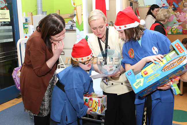 Hannah and Nollaig give presents out to the Children in The Lourdes Hospital...(Photo credit should read Jenny Matthews www.newsfile.ie)....This Picture has been sent you under the conditions enclosed by:.Newsfile Ltd..The Studio,.Millmount Abbey,.Drogheda,.Co Meath..Ireland..Tel: +353(0)41-9871240.Fax: +353(0)41-9871260.GSM: +353(0)86-2500958.email: pictures@newsfile.ie.www.newsfile.ie.