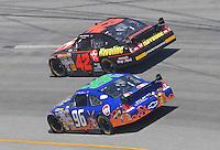 May 6, 2007; Richmond, VA, USA; Nascar Nextel Cup Series driver Juan Pablo Montoya (42) races alongside Tony Raines (96) during the Jim Stewart 400 at Richmond International Raceway. Mandatory Credit: Mark J. Rebilas