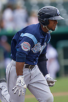 Corpus Christi Hooks outfielder Teoscar Hernandez (15) runs to first base during the Texas League baseball game against the San Antonio Missions on May 10, 2015 at Nelson Wolff Stadium in San Antonio, Texas. The Missions defeated the Hooks 6-5. (Andrew Woolley/Four Seam Images)
