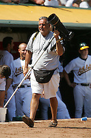 OAKLAND, CA - APRIL 17: TOPPS photographer Mickey Palmer works during the game between the Los Angeles Angels and Oakland Athletics at the Oakland-Alameda County Coliseum in Oakland, California on April 17, 2005. Photo by Brad Mangin