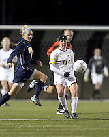 "Boston College defender Hannah Cerrone (11) passes the ball as West Virginia forward Megan Mischler (7) defends. Boston College defeated West Virginia, 4-0, in NCAA tournament ""Sweet 16"" match at Newton Soccer Field, Newton, MA."