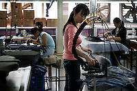 "Some of the industry of Huaxi Village (Farmers Village). This co op has been a model farm for 45 years.  They were capitalists before it was fashionable in China.  They started factories, but worked in them with no windows.  And when the government officials came around, they sent all the workers out to the fields and hid the factories.   They became the first and most successful capitalist exploitation of the collective.  This model farm became so successful they started selling shares in the 60's.  They sold the shares ""underground"" The residents now buy shares... or work for shares and that is what they buy their homes for.  When shares were first offered, they went for 2000RMB, now they go for 30,000 RMB.  I'm not quite sure how the government is involved... but they are... 30,000 officials visit this place to see how it is run every year.  There are not many model farms left in China... none with this wealth. It is held up by the government as the most successful transition from farmer to socialist/capitalist world.  The model farm runs about 80 factories..Party Secretary (Big Boss) is Sun Haiyan +86 139 0152 4019"
