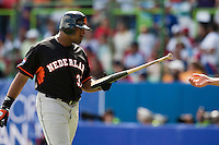 7 March 2009: #37 Bryan Engelhardt of the Netherlands gives back a broken bat to a bat boy during the 2009 World Baseball Classic Pool D match at Hiram Bithorn Stadium in San Juan, Puerto Rico. Netherlands pulled off a huge upset in their World Baseball Classic opener with a 3-2 victory over Dominican Republic.