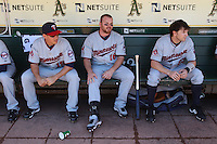 OAKLAND, CA - JUNE 6:  Danny Valencia #19, Jason Kubel #16, and Brendan Harris #23 of the Minnesota Twins get ready in the dugout before the game against the Oakland Athletics at the Oakland-Alameda County Coliseum on June 6, 2010 in Oakland, California. Photo by Brad Mangin