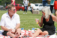 A couple enjoying themselves in the infield of Oaklawn on derby day. (Justin Manning/Eclipse Sportswire)