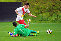 Phoenix keeper Tando Velaphi fouls George King during the ISPS Handa Premiership Football match between Wellington Phoenix Reserves and Canterbury United Dragons at David Farrington Park in Wellington, New Zealand on Sunday, 11 February 2018. Photo: Dave Lintott / lintottphoto.co.nz