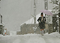 February 29, 2012, Tokorozawa, Japan - A school girl treads her way in the snow in Tokorozawa, Tokyos western suburb, on Wednesday, February 29, 2012. A freak early spring storm triggered by low pressure in the Pacific Ocean south of Japan brought fresh snow over wide swaths in the Kanto Area from the wee hour of Wednesday, disrupting land-sea-air transportation services. (Photo by Natsuki Sakai/AFLO) AYF -mis-