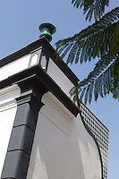 The whitewashed exterior of the villa has architectural elements highlighted in black