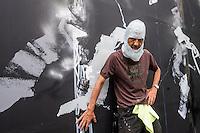 New York, NY 12 September 2015 -  Futura (aka Lenny McGurr, Futura 2000) photo op by his work-in-progress at the Bowery Mural