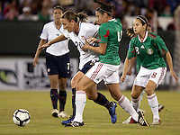 Abby Wambach of USA (L) during the semifinal match of CONCACAF Women's World Cup Qualifying tournament held at Estadio Quintana Roo in Cancun, Mexico. Mexico 2, USA 1.