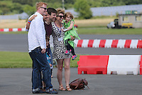 Chris Evans and Craig Phillips (Big Brother) pose for photos during The Children's Trust Supercar Event at Dunsfold Park, Surrey, England on 22 June 2014. Photo by Andy Rowland.