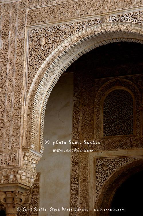 Nasrid palace facade in the Patio del Cuarto Dorado area of Alhambra, a 14th-century palace in Granada, Andalusia, Spain.