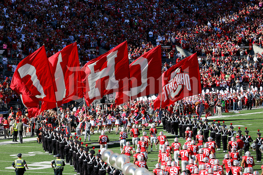 The Ohio State Buckeyes enter the field prior to the NCAA football game against the Indiana Hoosiers at Ohio Stadium in Columbus on Oct. 8, 2016. (Adam Cairns / The Columbus Dispatch)