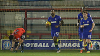 AFC Wimbledon's Tyrone Barnett pulls a goal back during the The Checkatrade Trophy match between AFC Wimbledon and Brighton & Hove Albion Under 21s at the Cherry Red Records Stadium, Kingston, England on 6 December 2016. Photo by Carlton Myrie / PRiME Media Images