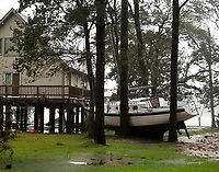 This photo provided by Angie Propst, shows a boat wedged in trees during Hurricane Florence in Oriental, N.C, one of nine incorporated municipalities in Pamlico County, Friday, Sept. 14, 2018.   (Angie Propst via AP)