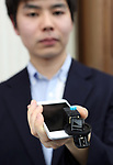 """March 9 2017, Tokyo, Japan - Go Kumagai, A student of University of Tokyo displays a small gadget to shoot panoramic picture with a smartphone """"Selfie 360"""" at a presentation of All Nippon Airways (ANA) crowdfunding """"WonderFLY"""" in Tokyo on Thursday, March 9, 2017. The Selfie 360 has a crockwork prismright-angled prism and which can take panoramic-view picture easily.    (Photo by Yoshio Tsunoda/AFLO) LwX -ytd-"""