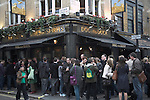 People drinking outside Dog and Duck pub, Bateman Street, Frith Street corner, London, England