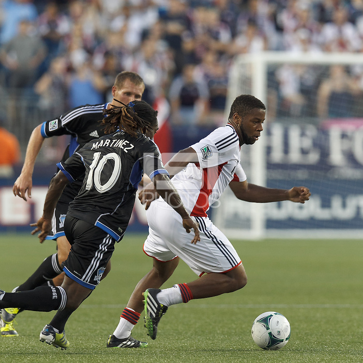 New England Revolution defender Andrew Farrell (2) on the attack.  In a Major League Soccer (MLS) match, the New England Revolution (white) defeated San Jose Earthquakes (black), 2-0, at Gillette Stadium on July 6, 2013.