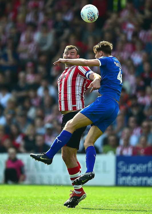 Lincoln City's Matt Rhead battles with Tranmere Rovers' Sid Nelson<br /> <br /> Photographer Andrew Vaughan/CameraSport<br /> <br /> The EFL Sky Bet League Two - Lincoln City v Tranmere Rovers - Monday 22nd April 2019 - Sincil Bank - Lincoln<br /> <br /> World Copyright © 2019 CameraSport. All rights reserved. 43 Linden Ave. Countesthorpe. Leicester. England. LE8 5PG - Tel: +44 (0) 116 277 4147 - admin@camerasport.com - www.camerasport.com