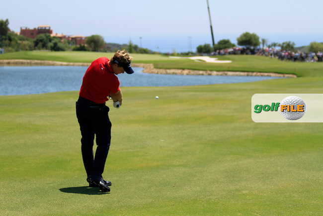 Luke Donald (ENG) takes his 2nd shot on the 3rd hole during the afternoon Final session on the Final Day of the Volvo World Match Play Championship in Finca Cortesin, Casares, Spain, 22nd May 2011. (Photo Eoin Clarke/Golffile 2011)