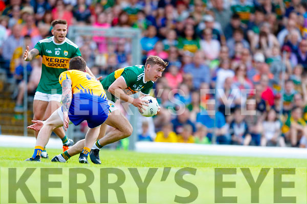 James O'Donoghue Kerry in action against Aaron Fitzgerald Clare during the Munster GAA Football Senior Championship semi-final match between Kerry and Clare at Fitzgerald Stadium in Killarney on Sunday.