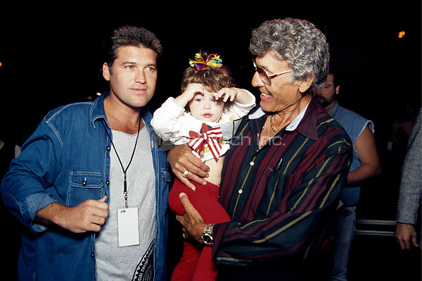 Billy Ray Cyrus and his daughter at the Elvis Presley Tribute in Memphis.<br /> October 8, 1994<br /> &copy; Scott Weiner /MediaPunch.