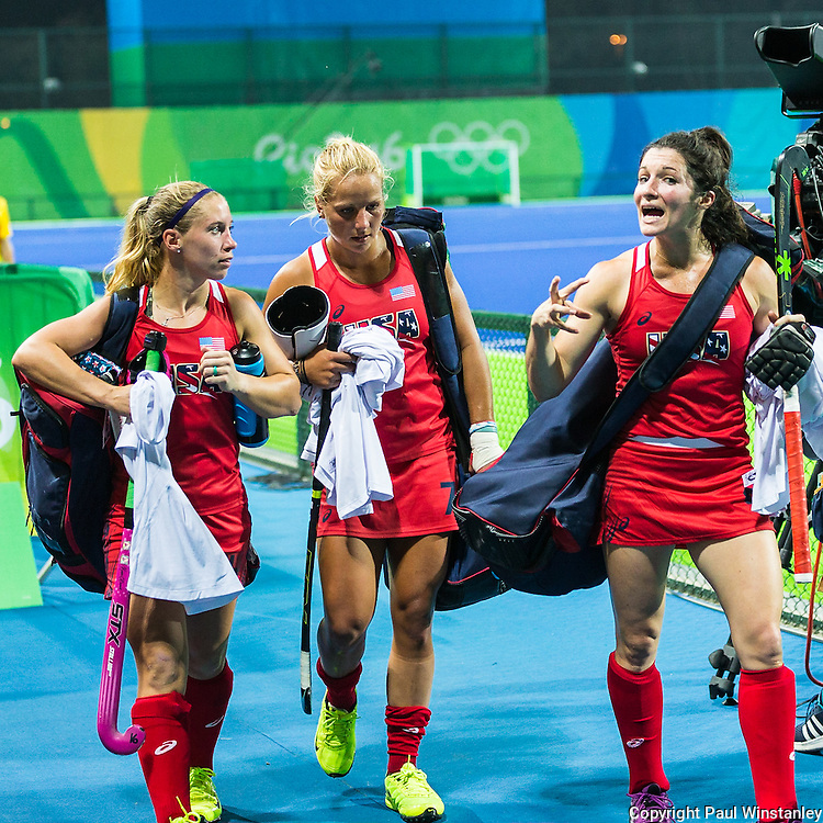Michelle Vittese #9 of United States talks while Katie Bam #16 of United States and Kelsey Kolojejchick #7 of United States listen after Argentina vs USA in a Pool B game at the Rio 2016 Olympics at the Olympic Hockey Centre in Rio de Janeiro, Brazil.
